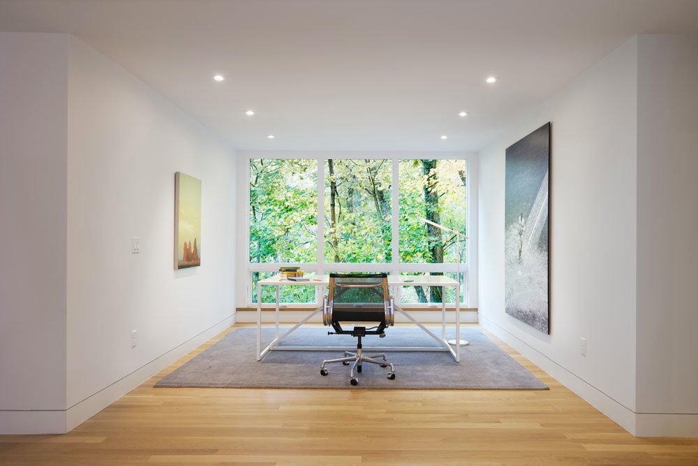 Situated on a sloped-site, each renovated space provides a unique perspective and vista to the dramatic natural surroundings. The office, with its stark modern furnishings and subtle artwork, allows the large window to serve as perhaps the most dramatic, singular frame to the foliage beyond.  Modern Victorian by Dwell from Beyond The Red Door