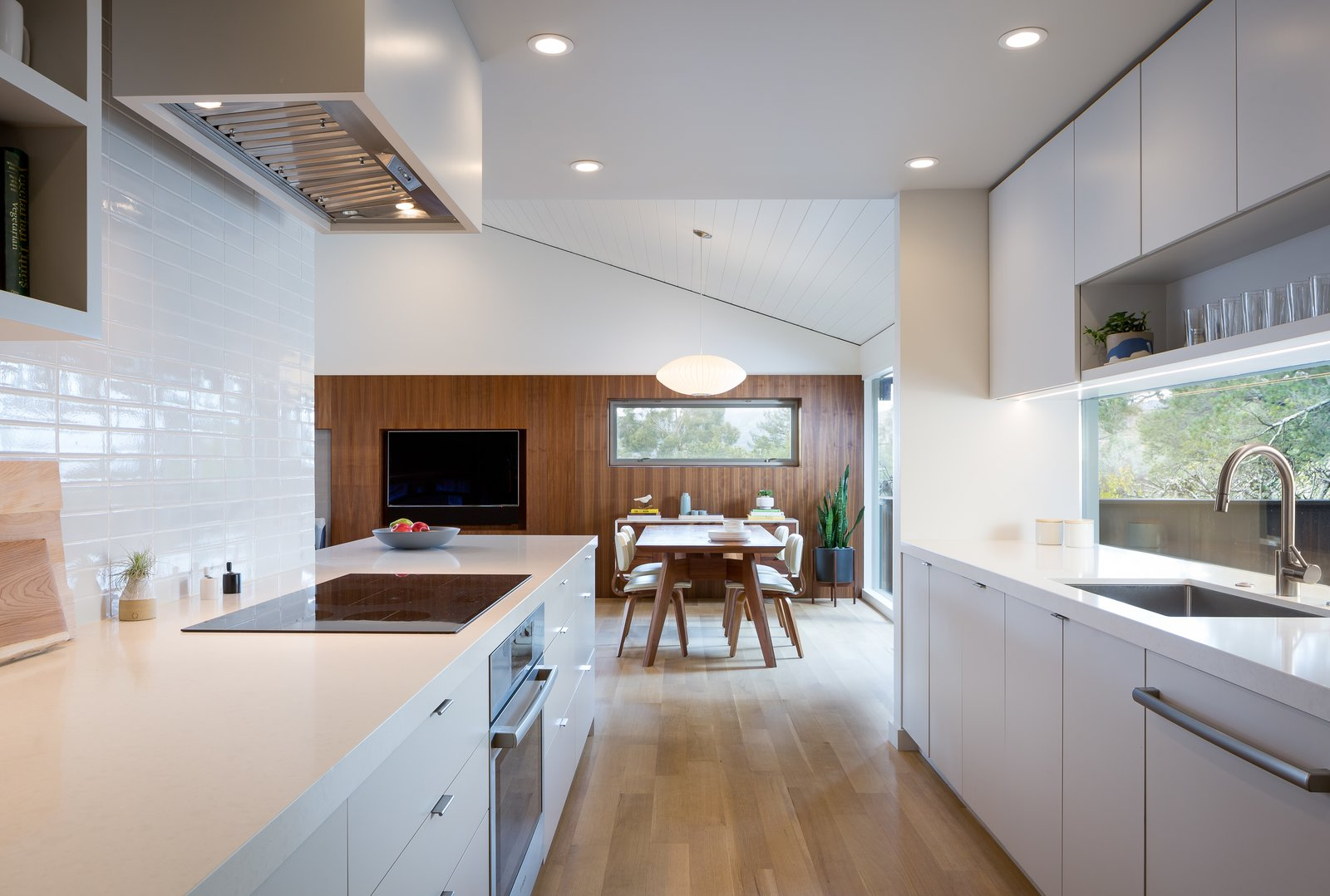 view of dining area from kitchen  Marin Midcentury by building Lab