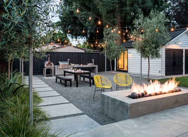 At dusk the fire and lighting extend the hours of use Photo 2 of Refreshing Bungalow modern home