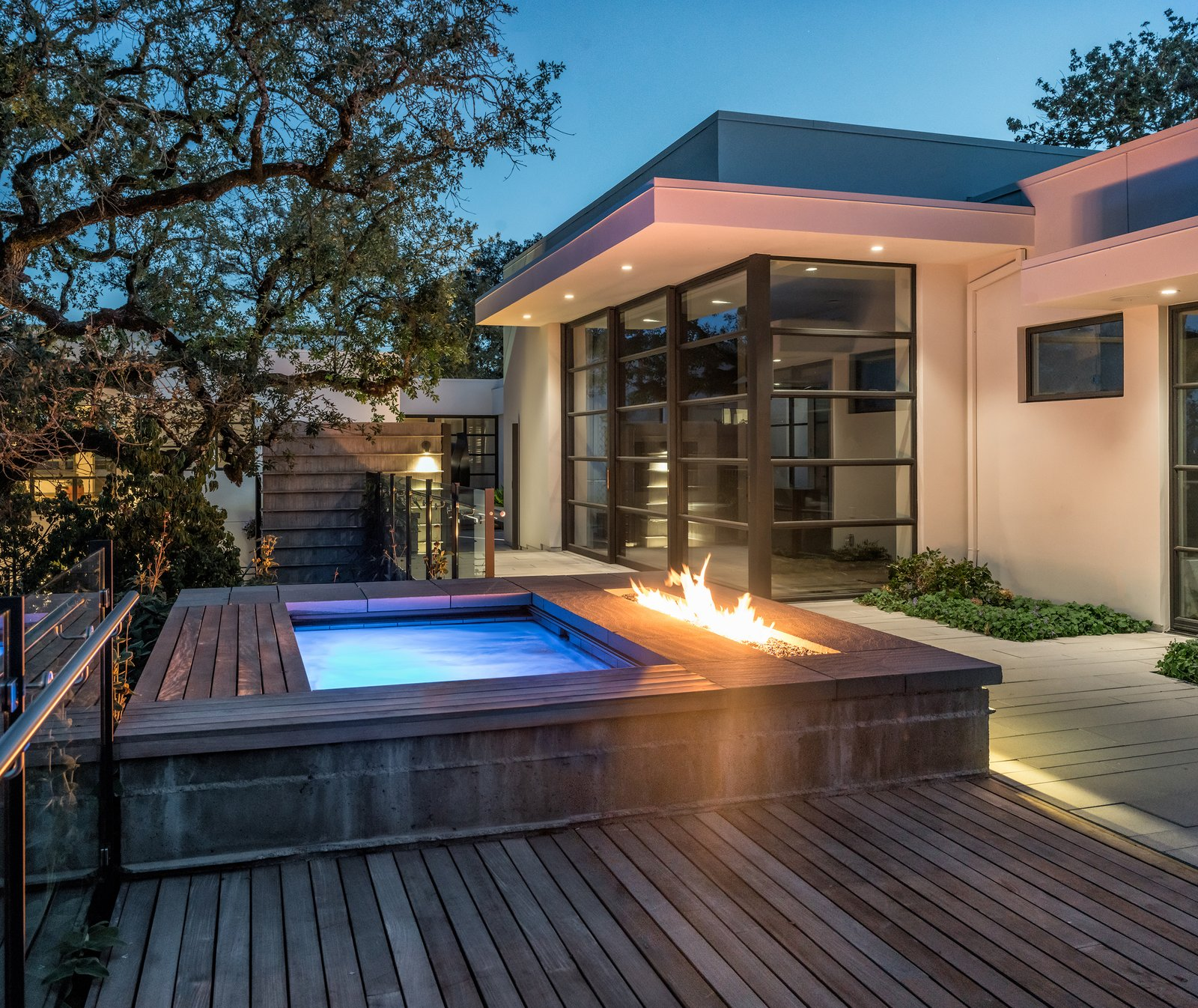 Lighted spa and fire feature at twilight Tagged: Outdoor, Wood Patio, Porch, Deck, Small Pools, Tubs, Shower, Concrete Patio, Porch, Deck, Trees, Shrubs, Small Patio, Porch, Deck, Hardscapes, Back Yard, and Landscape Lighting.  Hilltop Haven by Randy Thueme Design