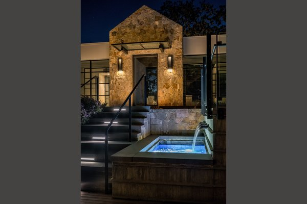 Modern home with outdoor, back yard, hardscapes, and landscape lighting. Elegant lighted water feature Photo 9 of Hilltop Haven