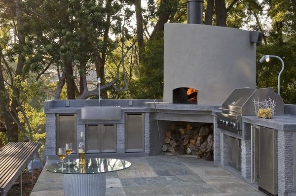 Modern home with outdoor, back yard, trees, hardscapes, and stone patio, porch, deck. An outdoor kitchen with pizza oven is conveniently located adjacent to the interior kitchen Photo 6 of Hideaway View