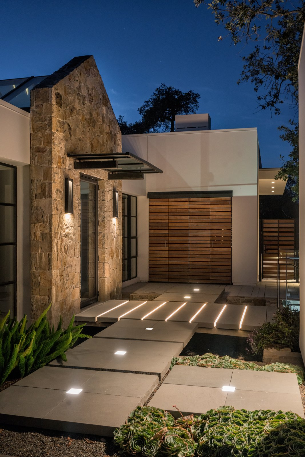 Innovative path lighting Tagged: Outdoor, Landscape Lighting, Concrete Patio, Porch, Deck, Horizontal Fences, Wall, Wood Fences, Wall, Hardscapes, Shrubs, Garden, and Walkways.  Hilltop Haven by Randy Thueme Design