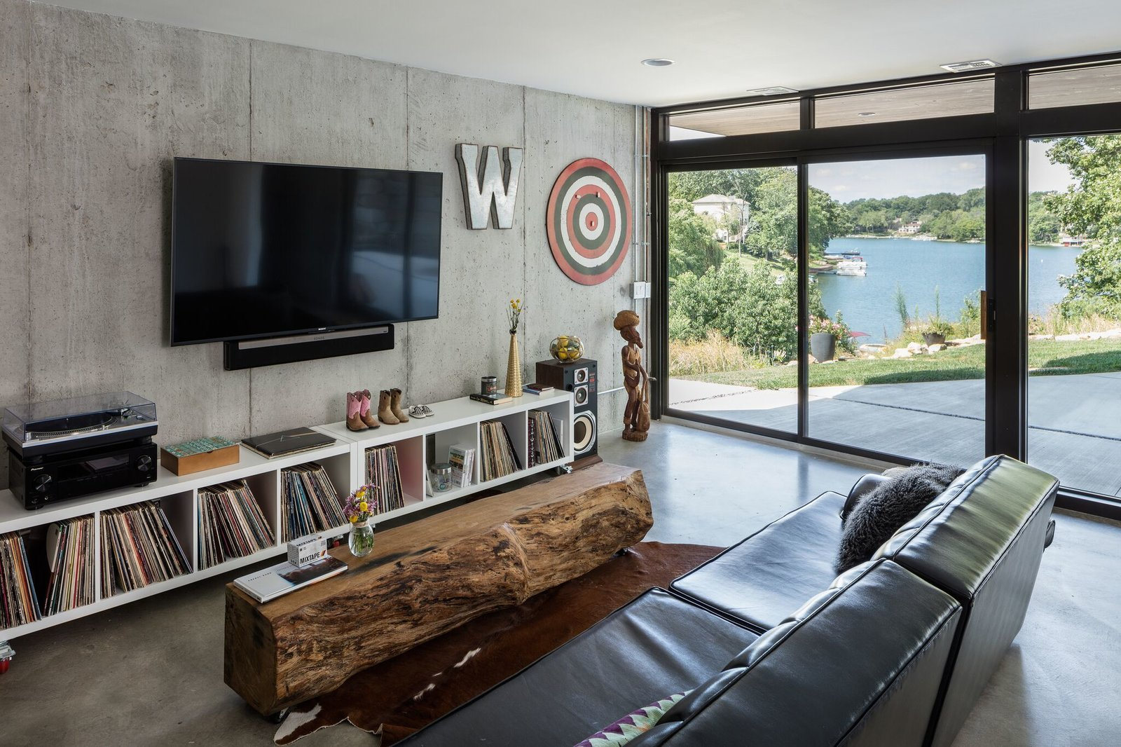 Living room with lake views Tagged: Living Room and Concrete Floor. Modern Lodge by Maria Doyle