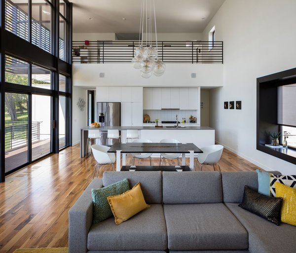 Modern home with dining room. Open kitchen and dining area - Space is saved without compromising spaciousness in the public living spaces by using an open plan.  Photo 3 of Modern Lodge