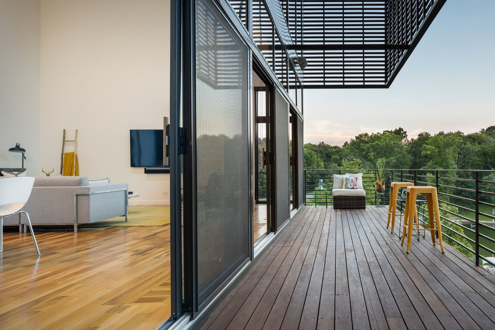 Living space opens to the deck Tagged: Outdoor.  Modern Lodge by Maria Doyle