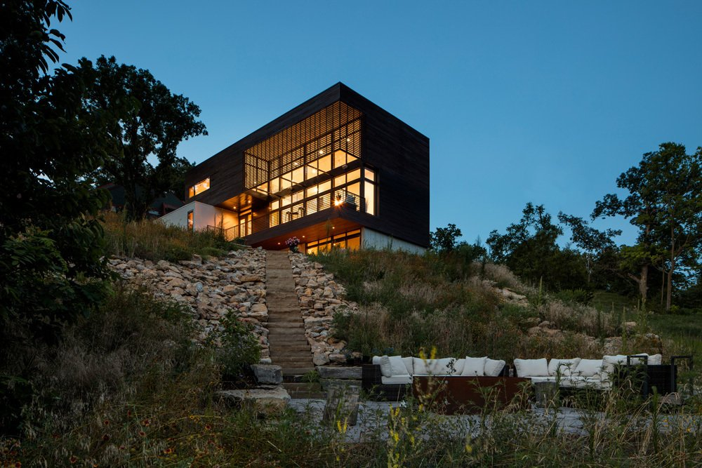 Modern Lodge in the evening Tagged: Outdoor, Front Yard, and Slope.  Modern Lodge by Maria Doyle