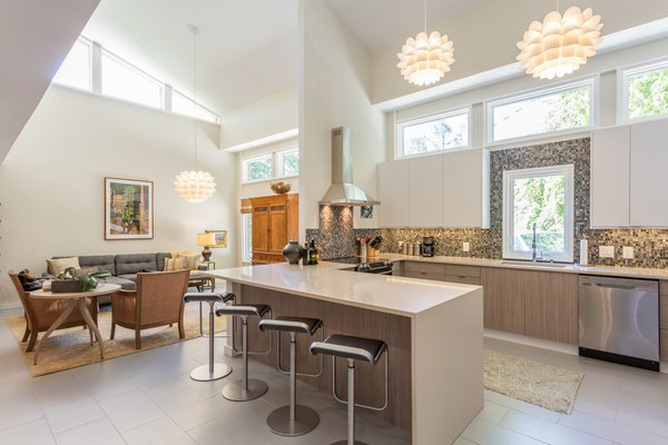 Kitchen! With hand-blown glass backsplash, waterfall quartz, soaring light-filled space Photo 11 of Sophisticated urban living in a pastoral setting - Available modern home