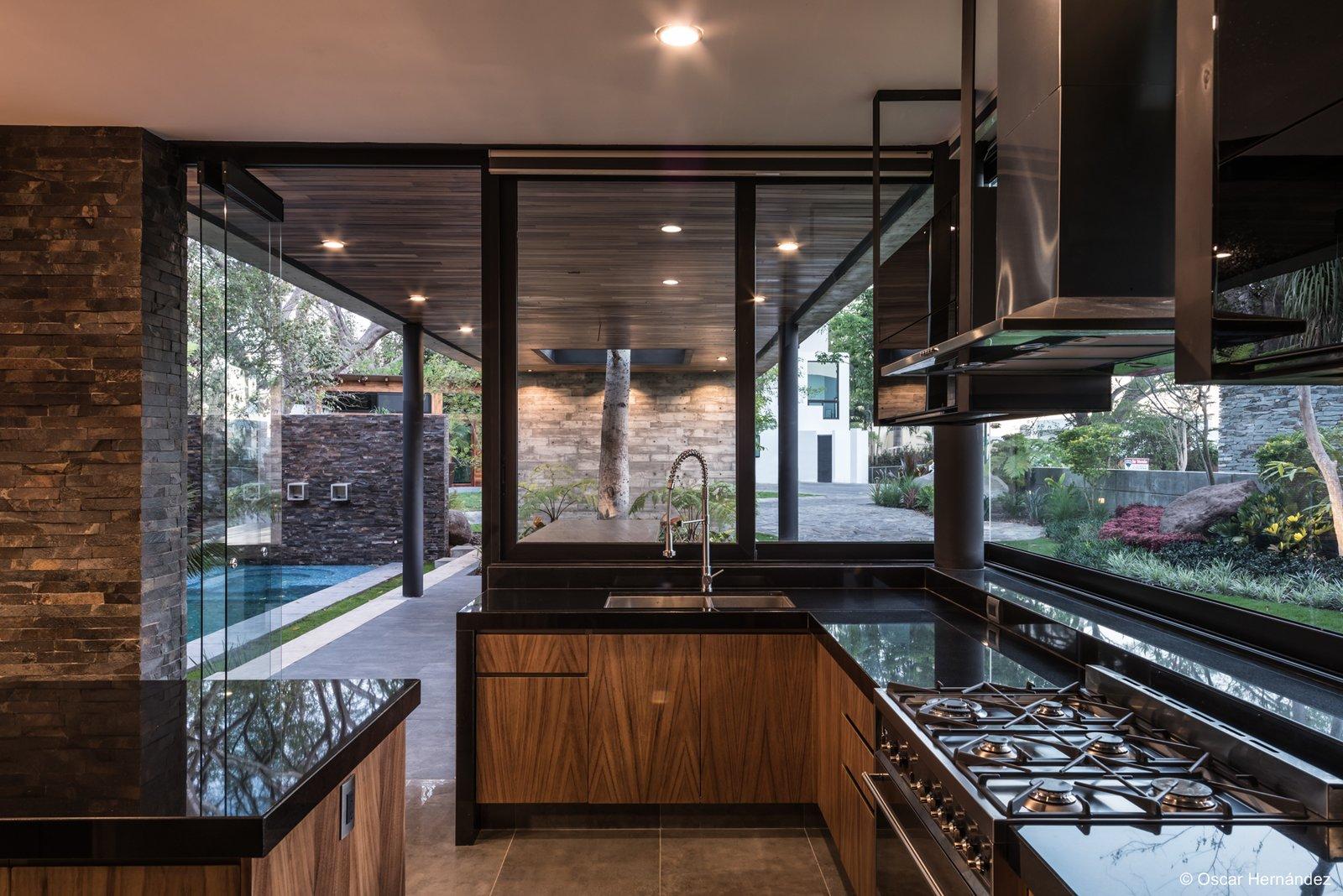 Iluminated kitchen  Casa Kalyvas by Taller de Arquitectura