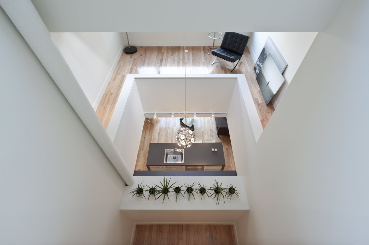 Shaft: looking from master bedroom toward the kitchen  Shaft House by rzlbd