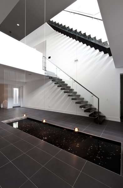 central void, staircase, reflection pool Photo 4 of 5/6 House modern home