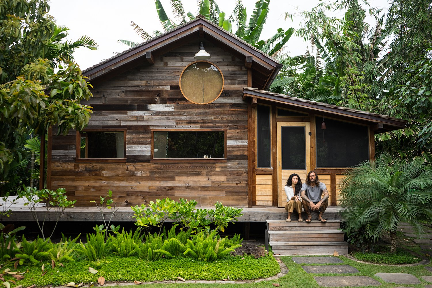Nestled away in a remote and lush coastal nook of the Hawaiian island chain is the dream home of filmmaker Jess Bianchi and jewelry designer Malia Grace Mau. Built by San Francisco-based artist Jay Nelson, the home is like being in an adult fort that reflects the sophisticated taste of its free-spirited, creative owners.  Photo 1 of 9 in A Couple's Dream Hawaiian Surf Shack