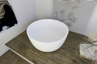 "Five Petite Modern Freestanding Bathtubs - Photo 2 of 5 - PureScape 720 is a minimalistic, freestanding, bowl-shaped tub, which has been hand crafted in Italy using Aquatica's technologically advanced AquateX™ solid surface material. Its soft, velvety surface juxtaposes the material's unparalleled heat retention and durability. With a petite footprint of 53.25"" in diameter, PureScape 720 is considerately designed for even the most compact of spaces."