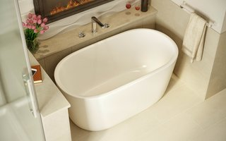 "Five Petite Modern Freestanding Bathtubs - Photo 1 of 5 - Lullaby Nano is Aquatica's take on creating a small deep bathtub that is ideal for a space conscious bathroom while providing that much loved modern freestanding design. Standing at just over 51"" in length, this chic pill-shaped tub has an extra deep ergonomically designed interior to ensure you enjoy a full-body soak. Crafted from Aquatica's technologically advanced AquateX™ solid surface material, Lullaby Nano offers a velvety soft matte surface and superior heat-retention and durability."