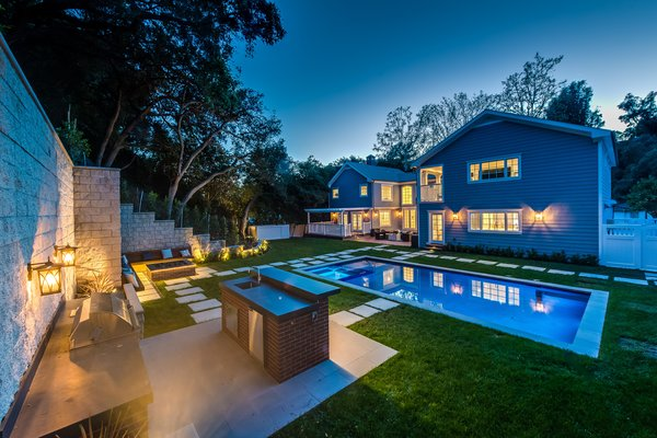 The backyard view at dusk Photo 5 of Brand New Cape Cod in Bel Air asks $6.75 million modern home