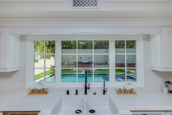 A kitchen window overlooking the gorgeous pool Photo 3 of Brand New Cape Cod in Bel Air asks $6.75 million modern home