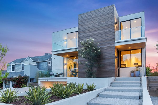 The entrance to the three-story home Photo  of 2017 Pacific Palisades Custom Home Draws Breathtaking Views for $6.5 million modern home