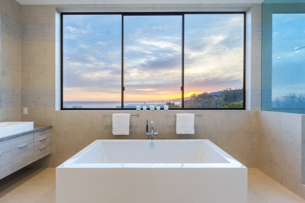 The master bath's soaking tub overlooks the sea Photo 3 of 2017 Pacific Palisades Custom Home Draws Breathtaking Views for $6.5 million modern home