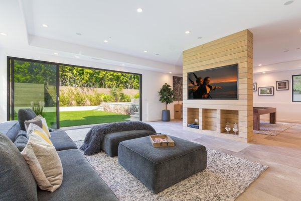 Indoor/outdoor family room Photo 4 of 2017 Pacific Palisades Custom Home Draws Breathtaking Views for $6.5 million modern home