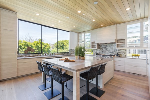 The kitchen includes a spacious center island Photo 5 of 2017 Pacific Palisades Custom Home Draws Breathtaking Views for $6.5 million modern home