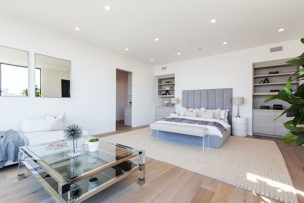 A spacious master bedroom fit with built-ins Photo 7 of 2017 Pacific Palisades Custom Home Draws Breathtaking Views for $6.5 million modern home
