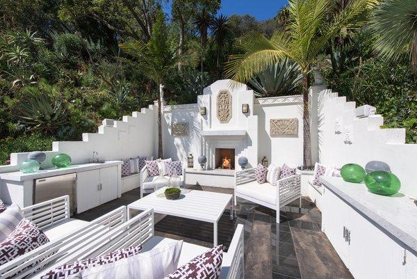 Beautifully adorned backyard patio Photo  of Max Ember's Art Deco Inspired Streamline Moderne modern home