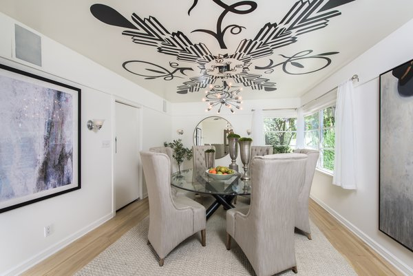 A cozy and warm dining room Photo 6 of Max Ember's Art Deco Inspired Streamline Moderne modern home