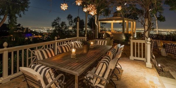 This impeccable Paul Williams-designed traditional rests on one of the few prized flag lots in Hollywood Hills' exclusive Bird Streets. French doors off nearly every room open to the fabulous backyard, which features multiple dining and lounge spaces, a built-in barbecue, gazebo, pool and spa—not to mention sweeping city-to-ocean views so breathtaking you'll want to dine al fresco every night of the week. Photo 4 of Four L.A. Homes with Phenomenal Outdoor Spaces for Spring modern home