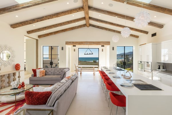 Kitchen and sitting nook designed with red accents and a hint of ocean views Photo 2 of Malibu Compound Designed By Douglas Burdge modern home