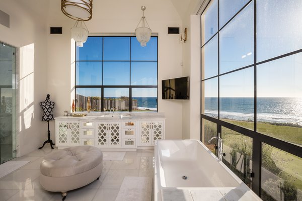 Master bathroom with soaking tub and again, ocean views Photo 4 of Malibu Compound Designed By Douglas Burdge modern home
