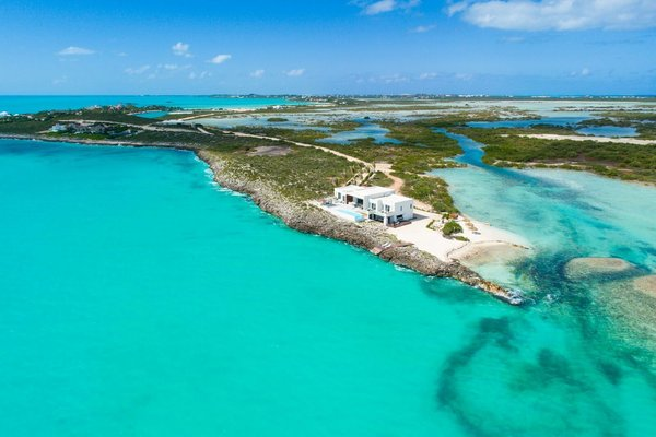 Situated on a 10,000-square-foot private beach and lagoon on the tail of Caicos Banks, the villa was masterfully designed for indoor-outdoor living.  Photo 2 of Tip of the Tail Villa modern home