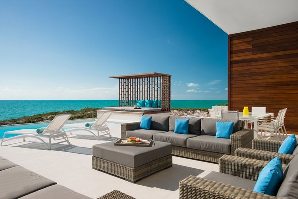 An expansive lounge area off the swimming pool is an incomparable retreat. Photo 6 of Tip of the Tail Villa modern home