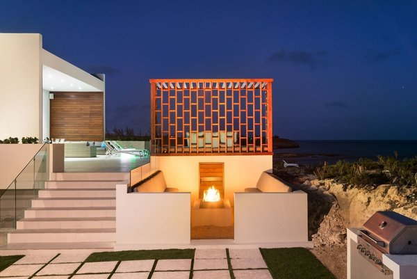 A fire pit enclave on the lower-level courtyard is the perfect place for post-dinner conversation. Photo 8 of Tip of the Tail Villa modern home