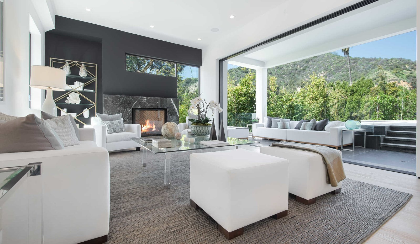 Sliding walls of glass reveal rolling canyons beyond the swimming pool and entertaining areas and create a seamless flow between indoor and outdoor living spaces.  Cherokee Contemporary by Luxury Homes + Lifestyle