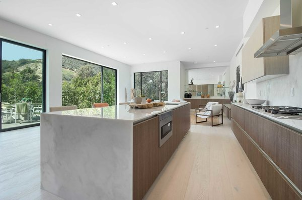 The gourmet Italian kitchen is complete with Miele appliances, a butler's pantry, eat-in island and Carrara marble countertops. Photo 5 of Cherokee Contemporary modern home