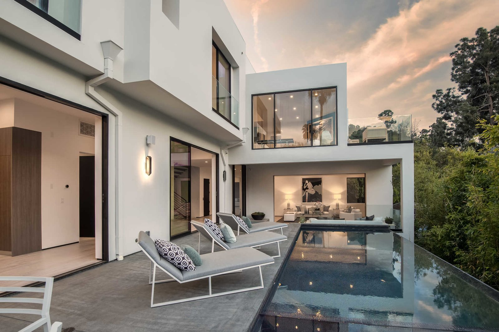 The swimming pool spills over lush canyon views.  Cherokee Contemporary by Luxury Homes + Lifestyle