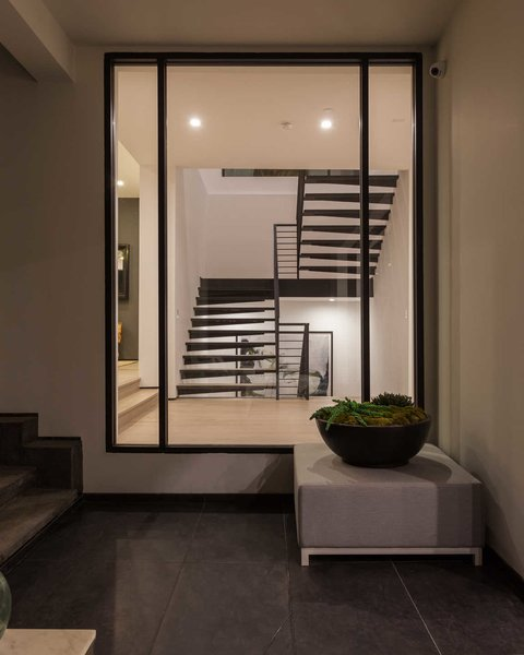 Large windows throughout the home create a feeling of continuity between indoor and outdoor living spaces. Photo 7 of Cherokee Contemporary modern home