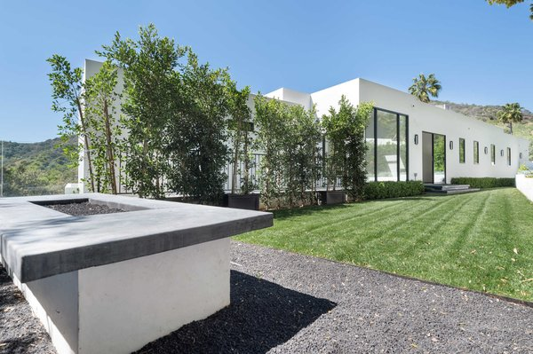 An additional grassy outdoor area with a large fire pit accessible from the second floor is a relaxing and private retreat. Photo 11 of Cherokee Contemporary modern home