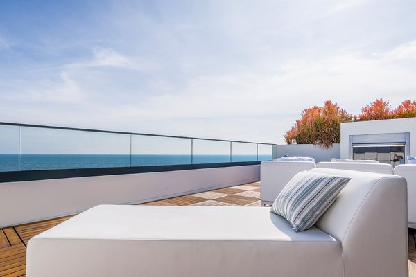 The private rooftop terrace overlooks the Pacific Ocean.  Photo  of Carbon Beach modern home