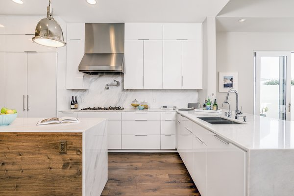Contemporary kitchen with white lacquer cabinetry and Italian marble Photo 4 of Carbon Beach modern home