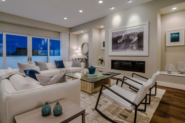 The Great Room with 12-foot ceilings, built-ins, fireplace and adjacent terrace Photo 7 of Carbon Beach modern home
