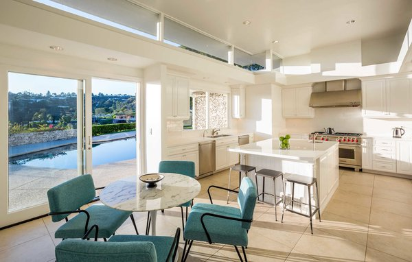 A newly remodeled kitchen boasts Wolf appliances and an eat-in breakfast island off the pool Photo 4 of Hillcrest Road modern home