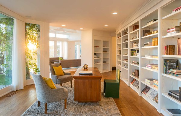A refined office showcases built in bookshelves and a seamless flow to the living room Photo 6 of Hillcrest Road modern home