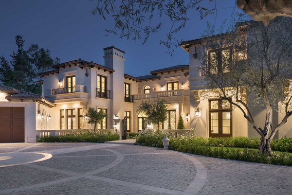 An expansive motor court of hand-laid granite leads to phenomenal living spaces. Photo  of Benedict Canyon Villa modern home