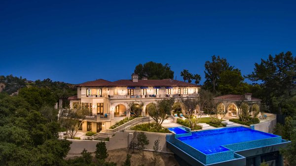 Situated atop a secluded canyon, the home boasts incredible outdoor space with multiple terraces and patios for grand-scale entertaining. Photo 2 of Benedict Canyon Villa modern home