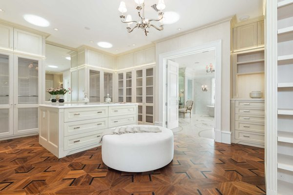 Dual showroom closets feature custom cabinetry, large center islands and security cameras, while Solatube light tunnels provide inimitable natural light.