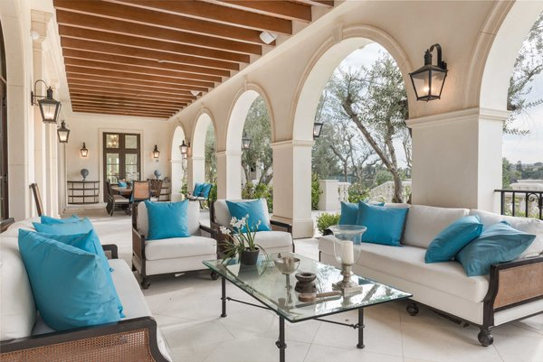 French doors off the great rooms lead to an expansive dining and lounging loggia. Photo 10 of Benedict Canyon Villa modern home