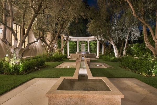 A serene water feature off the reflection garden. Photo 11 of Benedict Canyon Villa modern home