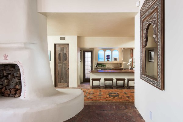 A double sided Moroccan fireplace boasts hand-painted details.  Photo 4 of Malibu Colony Road modern home