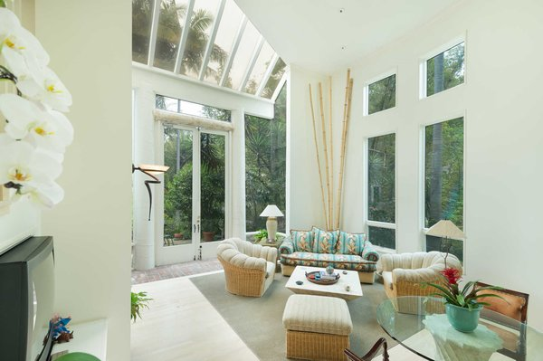 Towering ceilings and expansive windows take full advantage of the home's lush surroundings. Photo 5 of An Enchanting Nichols Canyon Hideaway With a Storied Bohemian Past modern home